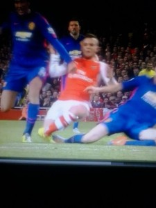 Wilshere being assaulted